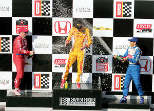 Dixon and Helio give Ryan a champagne bath!