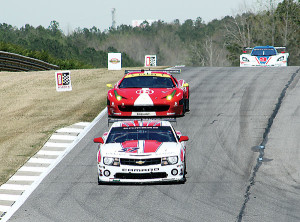 1st place GT Class Stevenson Camaro keeps 2nd place Westphal Balzan Ferrari 458 at bay.