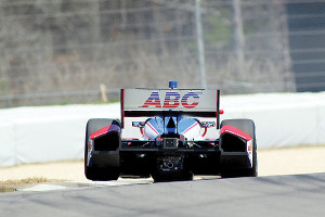 Takuma Sato goes over the 'rumble strip' at turn 9.