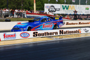 Dan Wilkerson's Summit Racing Funny Car leaves the starting line quickly.