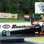 Junior Dragster race one winner Chris Bowdens dad Bobby does last minute check