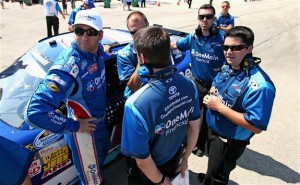 Elliott Sadler, driver of the #11 OneMain Financial Toyota (left), huddles with his crew after qualifying for the STP NASCAR Nationwide Series race at Chicagoland Speedway. (Credit: Jonathan Daniel/Getty Images)