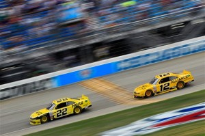 Joey Logano, driver of the #22 Hertz Ford, leads Sam Hornish Jr., driver of the #12 Alliance Truck Parts Ford, during the STP 300 NASCAR Nationwide Series race at Chicagoland Speedway on July 21, 2013 in Joliet, Illinois. (Credit: Chris Trotman/NASCAR via Getty Images)