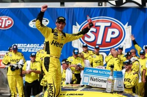 Joey Logano, driver of the #22 Hertz Ford, celebrates in Victory Lane following his win in the STP 300 NASCAR Nationwide Series race at Chicagoland Speedway on July 21, 2013 in Joliet, Illinois. (Credit: Chris Trotman/NASCAR via Getty Images)