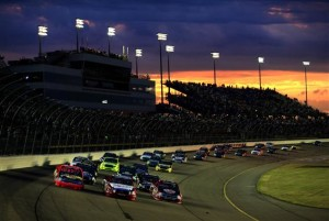 A general view of a race re-start as the sun sets during the NASCAR Camping World Truck Series American Ethanol 200 at Iowa Speedway on July 13, 2013 in Newton, Iowa.(Credit: Jamie Squire/NASCAR via Getty Images)