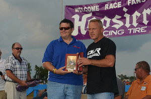 Lanigan receiving award at the National Dirt Late Model Hall of Fame Ceremony for his 2012 winnings