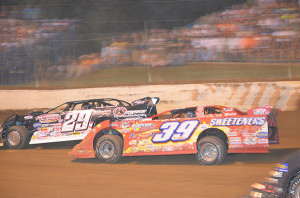Darrell Lanigan battling Ted McCreadie at the North-South 100