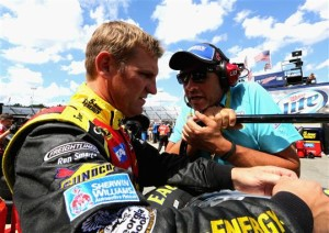 Clint Bowyer, driver of the #15 5-hour ENERGY Toyota, talks with team owner Michael Waltrip in the garage area during practice for the NASCAR Sprint Cup Series Federated Auto Parts 400 at Richmond International Raceway on September 6, 2013 in Richmond, Virginia.Credit: Jerry Markland/Getty Images