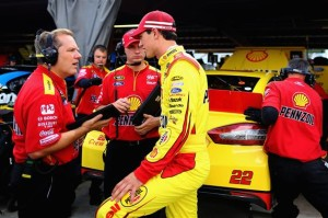 (R-L) Joey Logano, driver of the #22 Shell Pennzoil Ford, talks with crew chief Todd Gordon in the garage area during practice.Credit: Justin Edmonds/Getty Images