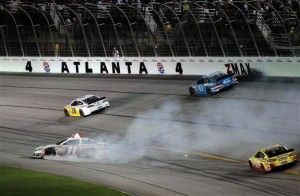 Denny Hamlin, driver of the #11 SportClips Toyota, slides across the apron.Credit: Matt Sullivan/Getty Images