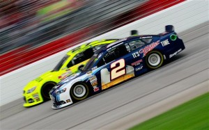Brad Keselowski, driver of the #2 Miller Lite Ford, races Paul Menard, driver of the #27 MOEN/Menard's Chevrolet, during the NASCAR Sprint Cup Series AdvoCare 500.Credit: Sean Gardner/NASCAR via Getty Images