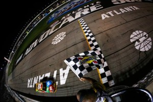 Kyle Busch, driver of the #18 M&M's Toyota, crosses the finish line to win the NASCAR Sprint Cup Series AdvoCare 500.Credit: Jeff Zelevansky/Getty Images