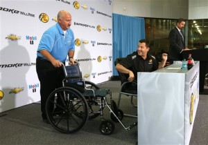 (L-R) Josh Katz pushes the wheelchair of Tony Stewart, NASCAR Sprint Cup Series driver and co-owner of Stewart-Haas Racing, before he speaks to the media in his first appearance since his sprint car accident at Stewart-Haas Racing on September 3, 2013 in Kannapolis, North Carolina.Credit: Streeter Lecka/NASCAR via Getty Images
