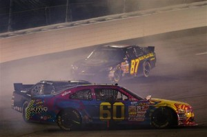 Travis Pastrana, driver of the #60 Roush Fenway Racing Ford, is involved in an on-track incident .Credit: Justin Edmonds/Getty Images