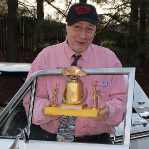 Captain Herb with the 1953 Peach Bowl trophy given to him