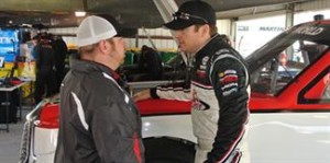 Timothy Peters and crew chief Marcus Richmond talk strategy.Photo courtesy of Martinsville Speedway