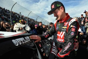 Kurt Busch, driver of the #41 Haas Automation Chevrolet, applies the winner sticker in Victory Lane after winning the NASCAR Sprint Cup Series STP 500 at Martinsville Speedway.Photo: Rainier Ehrhardt/NASCAR via Getty Images