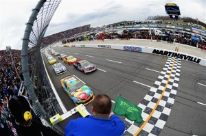 Kyle Busch, driver of the #18 M&M's Toyota, leads the field to the green flag for the start of the NASCAR Sprint Cup Series STP 500 at Martinsville Speedway on March 30, 2014 in Martinsville, Virginia.Photo: Robert Laberge/NASCAR via Getty Images