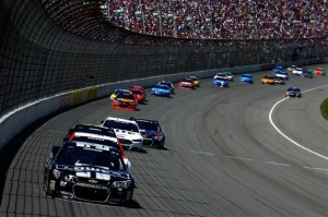Jimmie Johnson, driver of the #48 Lowe's/Kobalt Tools Chevrolet, leads a pack of cars during the NASCAR Sprint Cup Series Quicken Loans 400 at Michigan International Speedway on June 15, 2014 in Brooklyn, Michigan.Credit: Chris Trotman/Getty Images