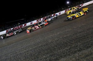 Darrell Wallace Jr. , driver of the #54 ToyotaCare Toyota, leads a group of cars during the Camping World Truck 2nd Annual 1-800 Car Cash Mudsummer Classic at Eldora Speedway on July 23, 2014 in Rossburg, Ohio.<BR<Photo: Sean Gardner/NASCAR via Getty Images