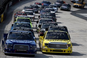Brad Keselowski, driver of the #19 DrawTire Ford, leads Kyle Busch, driver of the #51 Dollar General Toyota, and the rest of the field .Photo: Patrick Smith/NASCAR via Getty Images