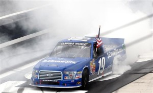 Brad Keselowski, driver of the #19 DrawTite Ford, celebrates after winning the NASCAR Camping World Truck Series UNOH 200 presented by ZLOOP at Bristol Motor Speedway on August 21, 2014 in Bristol, Tennessee.Photo:  Brian Lawdermilk/Getty Images