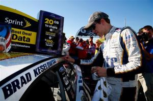 Brad Keselowski, driver of the #2 Miller Lite Ford, puts the winner's sticker on his car in victory lane after winning the NASCAR Sprint Cup Series MyAFibStory.com 400 at Chicagoland Speedway on September 14, 2014 in Joliet, Illinois.Photo: Matt Sullivan/NASCAR via Getty Images