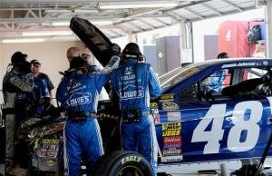 Crew members for Jimmie Johnson, driver of the #48 Lowe's Chevrolet, work on the car after a crash during the NASCAR Sprint Cup Series Hollywood Casino 400Photo: Jared C. Tilton/Getty Images