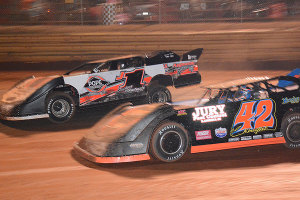 Bishop in the #J1 battles for position with Clay Knight #42 for position.