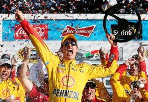 Joey Logano celebrates in victory lane after winning Sunday's Daytona 500 on a green-white-checkered finish Sunday afternoon. Photo by Chris Graythen/Getty Images