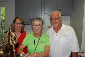 Left to right: Angela Sieli, three time NHRA Top Fuel World Shirley Muldowney and Paul Sieli