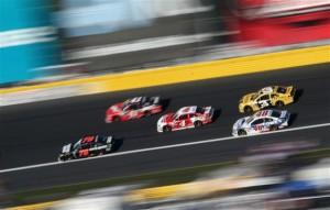 Martin Truex Jr., driver of the #78 Furniture Row/Visser Precision Chevrolet, leads a pack of cars.Credit: Streeter Lecka/Getty Images