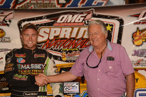 Donald McIntosh being congratulated by Dixie Speedway's Mickey Swims
