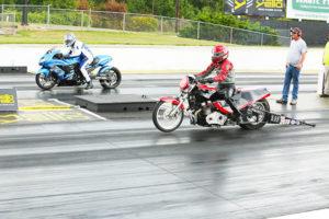 Super Pro Bike winner Tim Sutton, near lane and Randy Day in far lane
